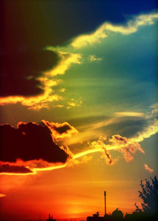 Rainbow colours lie above us.