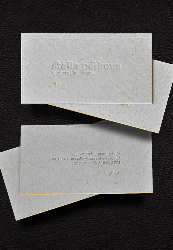 Blind deboss and golden foil on 1,5mm grey cardboard.