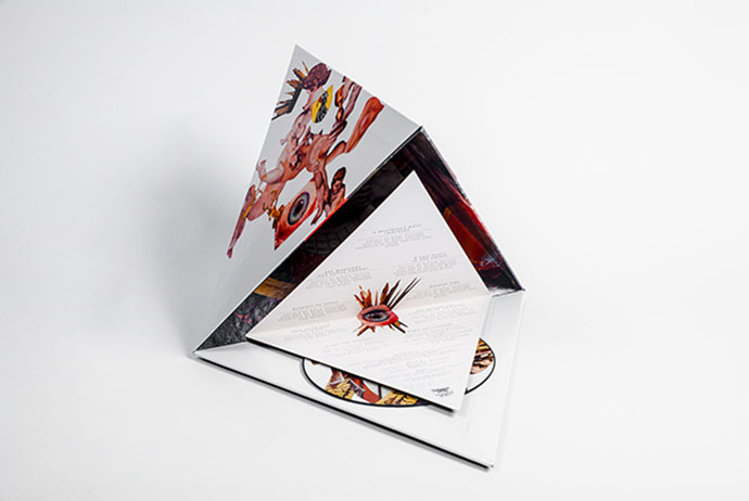 Deluxe pyramid-shaped box for Manes album