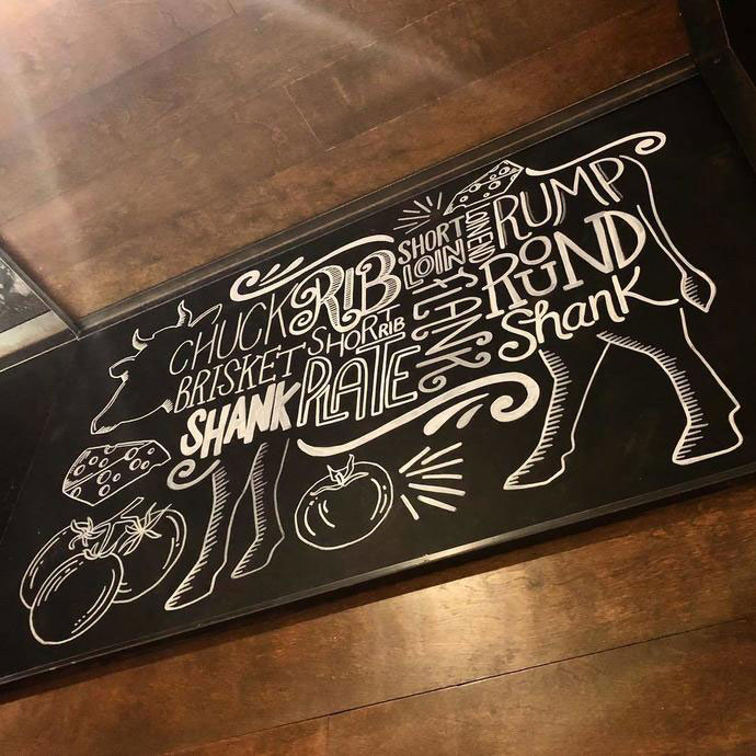 Cow drawing with typography